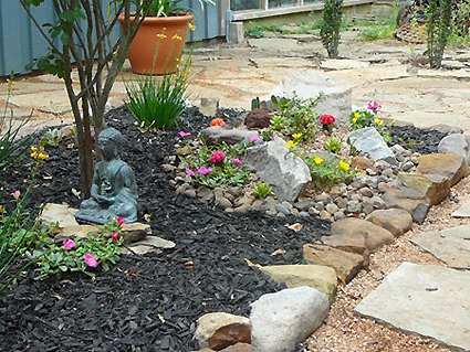 Because of the large stump left under the ground from that huge oak tree I wasn't able to plant things I had planned.  One side of the flower bed turned into a rock garden because of it.  It's colorful, anyway.