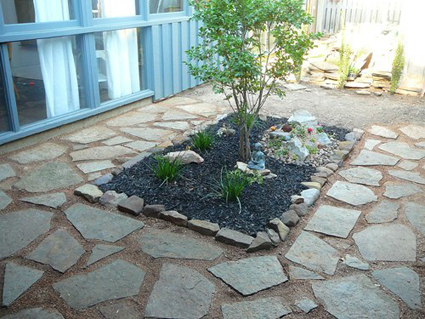 I brought back each rock and then created a rectangular bed with smaller rocks for some plants.  I then filled in between the large stepping stones with crushed granite.