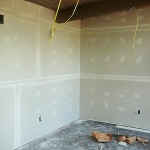 Paneling was down and the sheetrock went up.  Big difference.