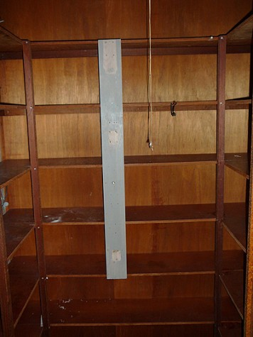 There is a small but suitable kitchen pantry that was pretty rough.  It had exposed electrical wires and wasn't workable.