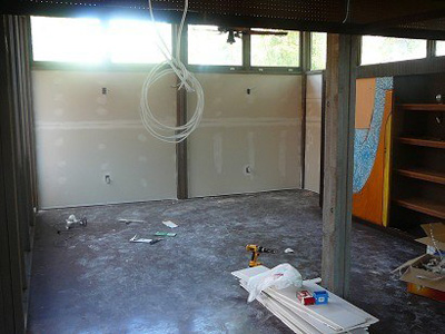 Paneling came down and sheetrock went up.  Much brighter and better.