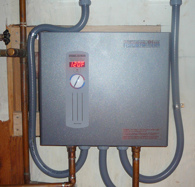 The old water heater tank was taken out and my new tankless heater went in.  I will never go back to a tank, this delivers endless hot water and we are so happy with it.  It's so small too.