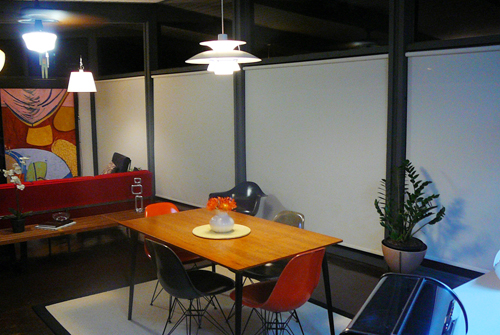 Here's a night shot of the small dining area in the middle of the living room and kitchen.  It's a big open space that serves so many purposes.  The solar shades really help brighten the space at night.  All those windows can make things dark.  We love them.