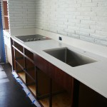 Once I stained the cabinets the Silestone tops in Blanco Maple were installed. I also painted all the brick white which helped BIG TIME!